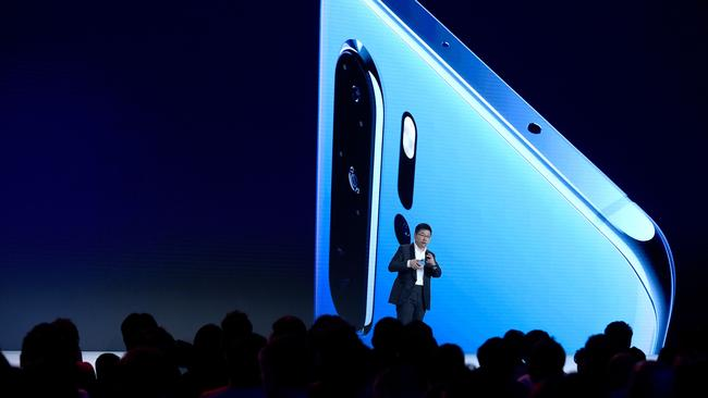 Chinese Telecom equipment company Huawei Consumer Products division CEO Richard Yu gestures as he speaks on stage during the presentation the new P30 smartphone. Picture: Eric Piermont