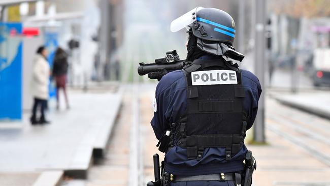 A riot police officer holds a flash ball gun during a demonstration against French government Education reforms on December 3, 2018 in Bordeaux, southwestern France. Picture: AFP