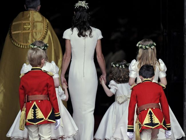 Maid of honour Pippa Middleton arrives with page boys and ring bearers. Picture: AP