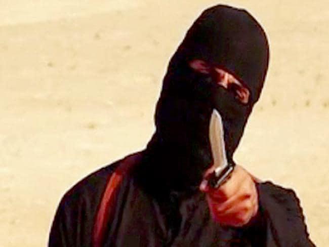 "The infamous ""Jihadi John"" speaks to the camera before a beheading."