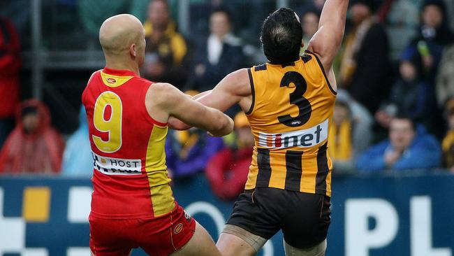 Jordan Lewis battles with Gary Ablett. Picture: Colleen Petch