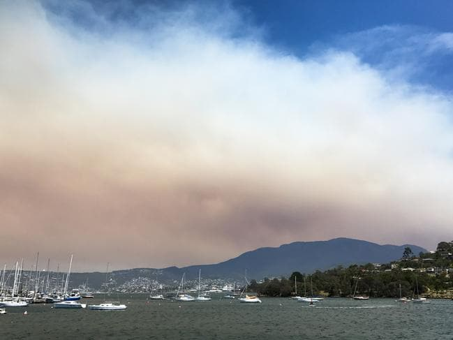 Smoke from an out-of-control bushfire Wilderness World Heritage area in southwest Tasmania has covered Hobart. Picture: AAP
