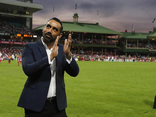 Sydney Swans great Adam Goodes is cheered during his lap of honour at the SCG.
