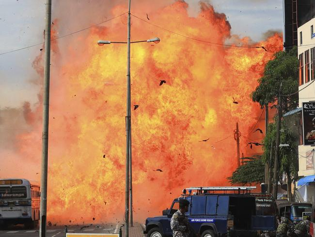 A suspicious object explodes without warning near police in Colombo, Sri Lanka. Picture: The Yomiuri Shimbun via AP