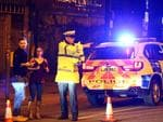 Police stand by a cordoned off street close to the Manchester Arena in Manchester, England. Picture: Getty