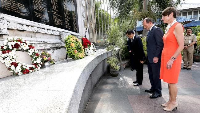 Prime Minister Tony Abbott and his wife Margie lay a wreath at the Bali memorial with former police chief Made Pastika. Picture: Ray Strange