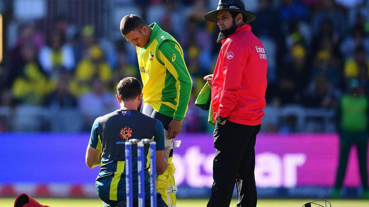 Usman Khawaja receiving treatment on his troublesome hamstring. (Photo by Clive Mason/Getty Images)