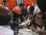 Rescuers check an earthquake survivor at restaurant building damaged by a massive earthquakes and tsunami in Palu, Central Sulawesi, Indonesia, Sunday, Sept. 30, 2018. Rescue officials feared the full scale of Indonesia's earthquake and tsunami could climb far past the more than 800 already confirmed dead, as several large coastal towns remained cut off Sunday by damaged roads and downed communication lines. Picture:AP Photo/Tatan Syuflana