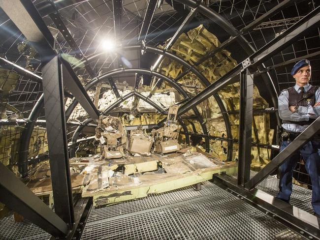 Inside the reconstructed plane ... what was left after the Buk missile struck. Picture: Ella Pellegrini