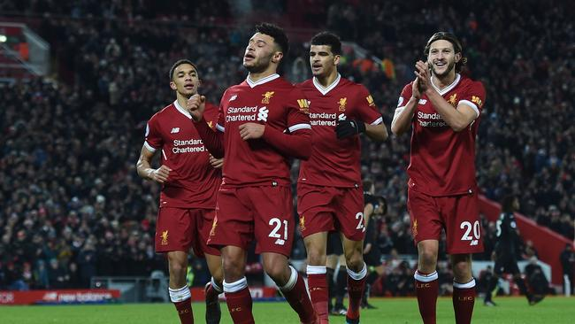 Liverpool's English midfielder Alex Oxlade-Chamberlain (2L) celebrates a goal