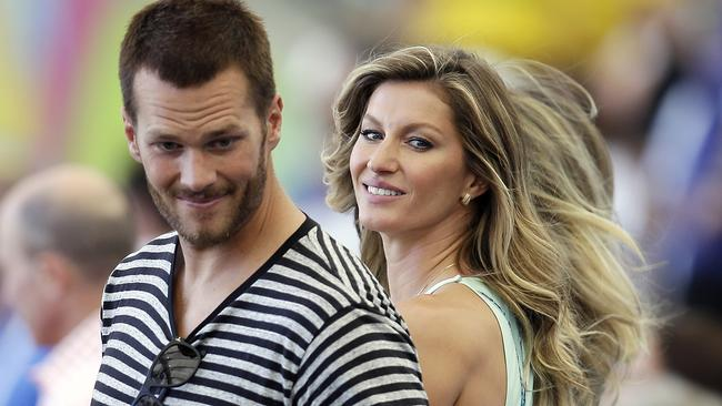 Brazilian beauty ... Tom Brady and Gisele Bündchen attend the World Cup final in Rio on July 13. Picture: Hassan Ammar