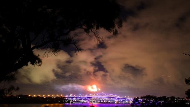Fireworks lit up the cloudy New Zealand sky. Picture: Phil Walter/Getty