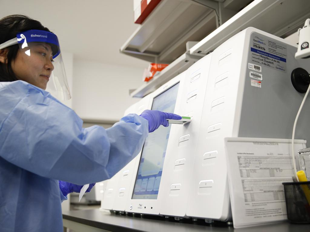 A laboratory technician prepares COVID-19 patient samples for semiautomatic testing at a lab in New York. Picture: AP