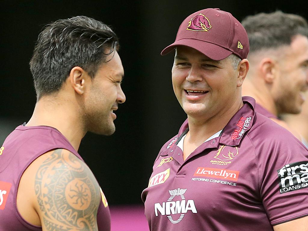 Broncos coach Anthony Seibold (right) speaks with Alex Glenn during a Brisbane Broncos training session at Red Hill in Brisbane, Monday, January 7, 2019. (AAP Image/Jono Searle) NO ARCHIVING