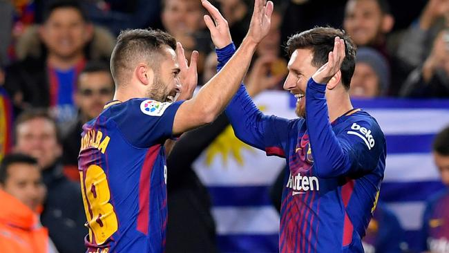 Barcelona's Argentinian forward Lionel Messi (R) celebrates with Barcelona's Spanish defender Jordi Alba.