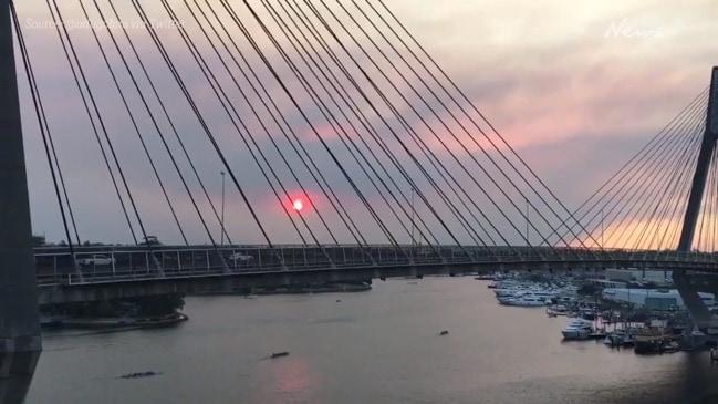 Sydney chokes through eerie red smoke haze sunset