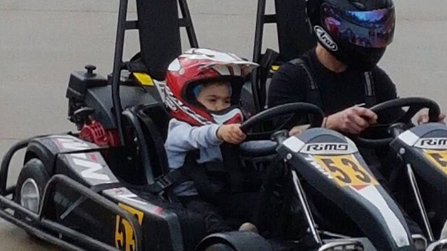 Antonio and his father at Go Kart's Go in the Hunter Valley — they allow four to five year old's to get behind the wheel when accompanied by an adult.