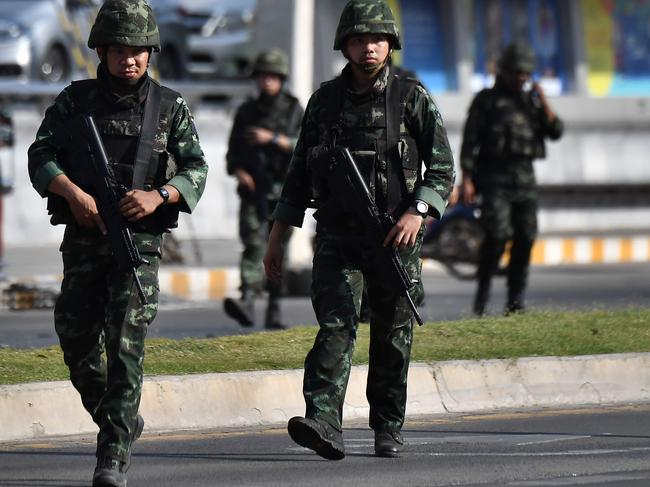 Soldiers walk on the street near the Terminal 21 mall. Picture: AFP