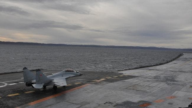 A Mig-29K multi-role fighter is positioned for a run towards Admiral Kuznetsov's ski-ramp. Picture: TASS