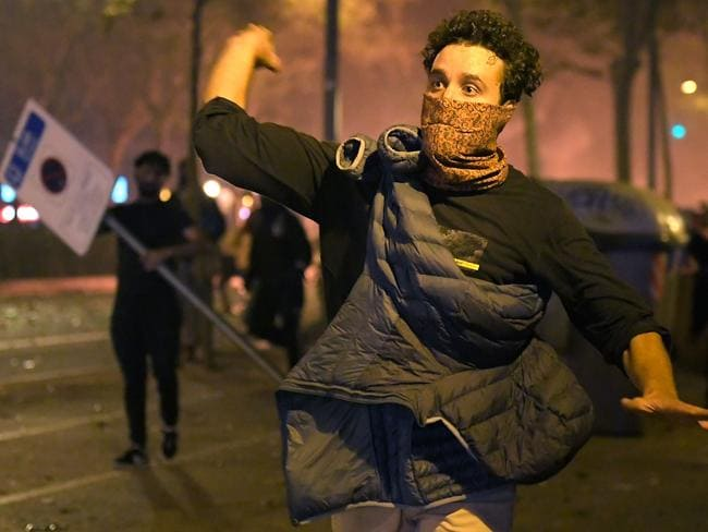 A protester hurls an object at police during the violence. Picture: AFP