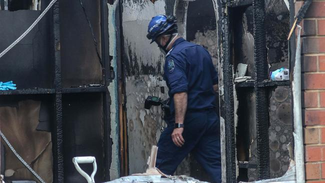 A fire investigator at the tragic scene. Picture: AAP Image/Russell Millard