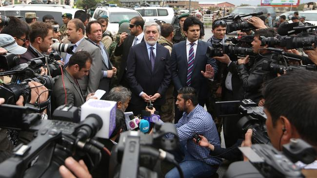 Afghanistan Chief Executive Abdullah Abdullah, center, speaks with journalists at the site of the deadly suicide attack.