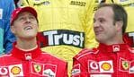 Australian Grand Prix Race day. Michael Schumacher is distracted by the airshow as the planes go overhead while team-mate Rubens Barrichello talks with him.