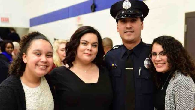 Police officer Ivan Soto, pictured with his hairdresser wife and teenage daughters, left his home to burn as he helped residents escape. Picture: GoFundMe