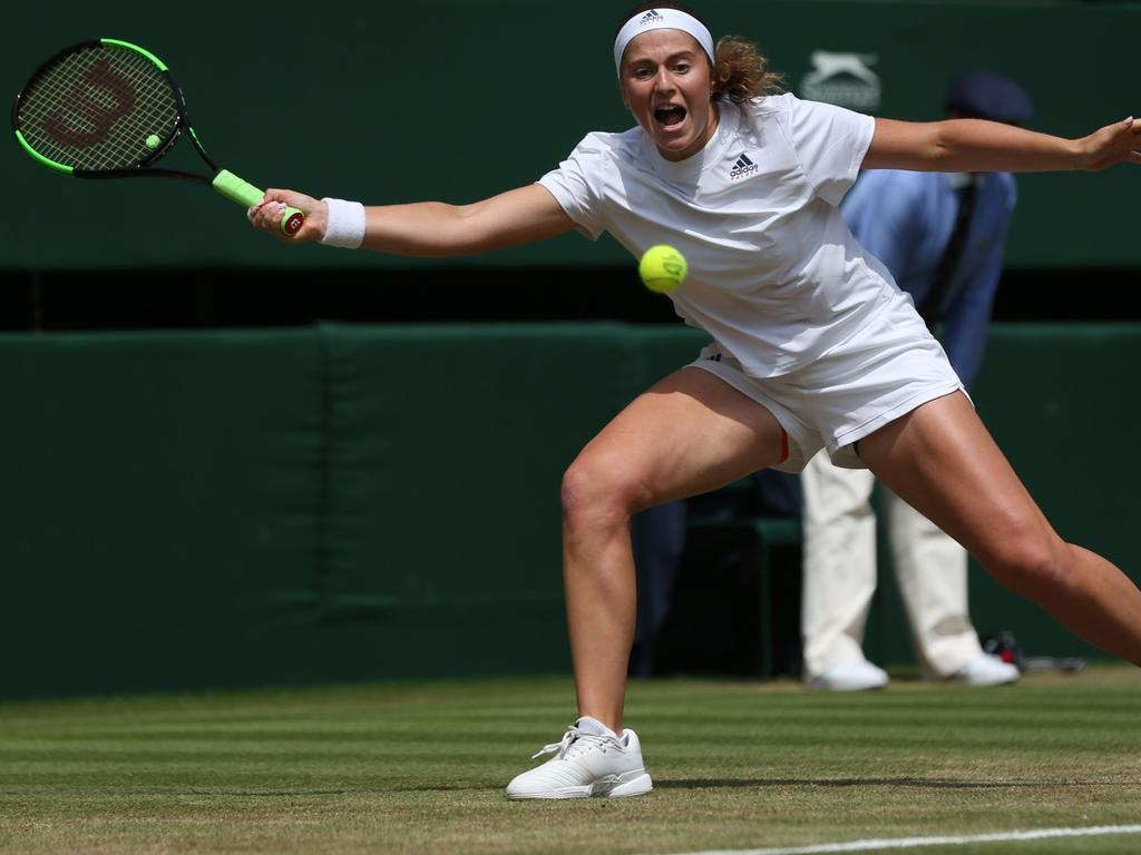 Jelena Ostapenko stretches to reach the ball.