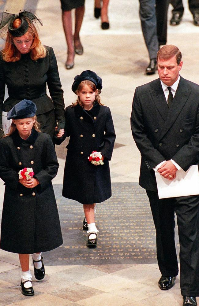 The Duchess of York, Sarah Ferguson, her former husband Andrew, the Duke of York, and their two daughters Beatrice and Eugenie arrive into Westminster Abbey in London to attend the funeral ceremony of Diana, Princess of Wales. Picture: AFP