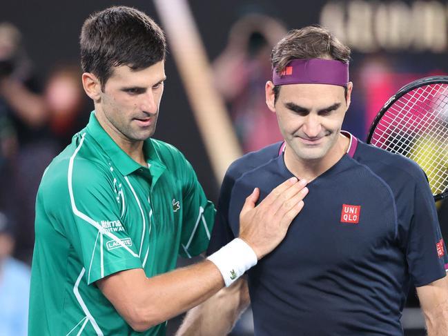 Djokovic consoles Federer after the brutal Australian Open semi-final.