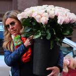 Is it a boy or a girl? Pink flowers here but there were an array of coloured flowers delivered to the hotel. Picture: Splash News