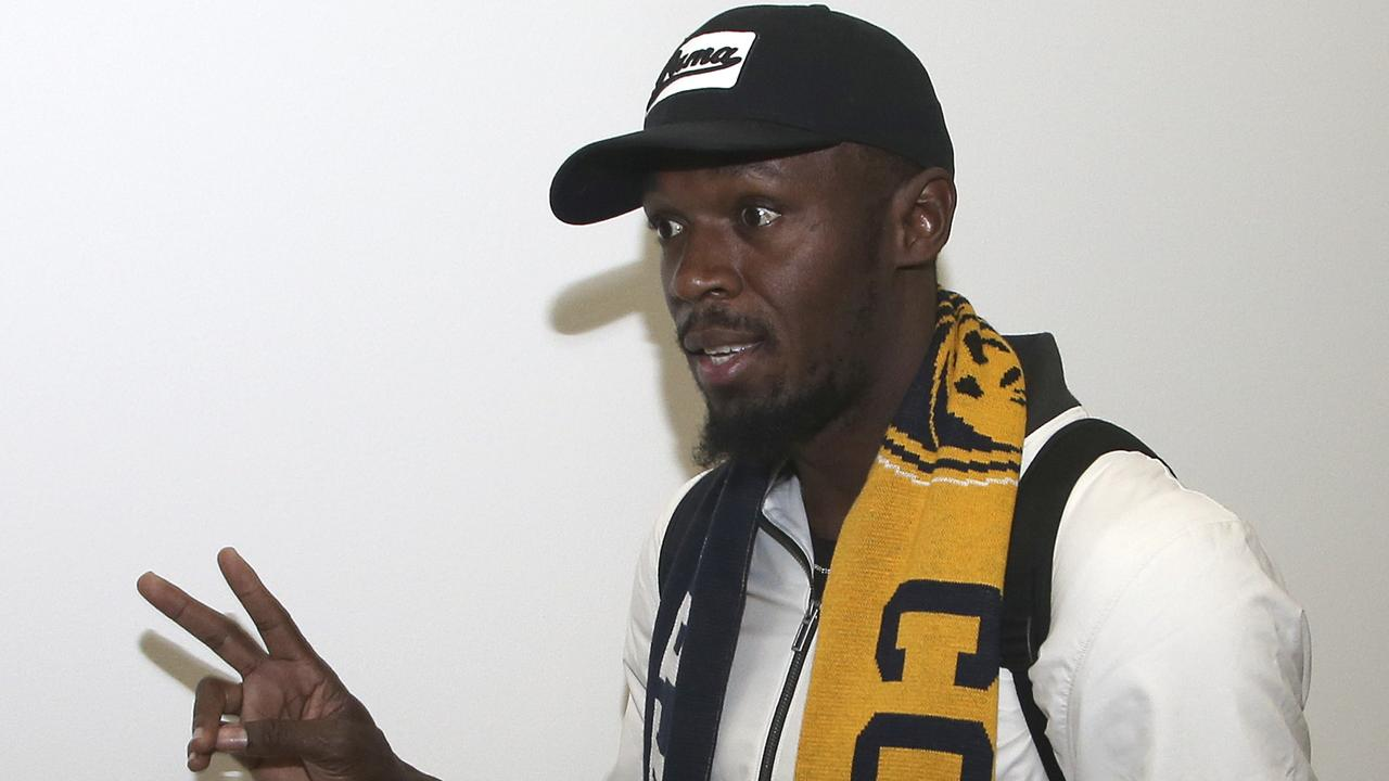 Jamaica's Usain Bolt waves as he arrives in Sydney.