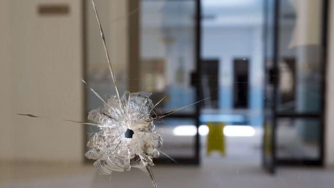 A photo shows a bullet hole on a window in the Riu Imperial Marhaba Hotel.