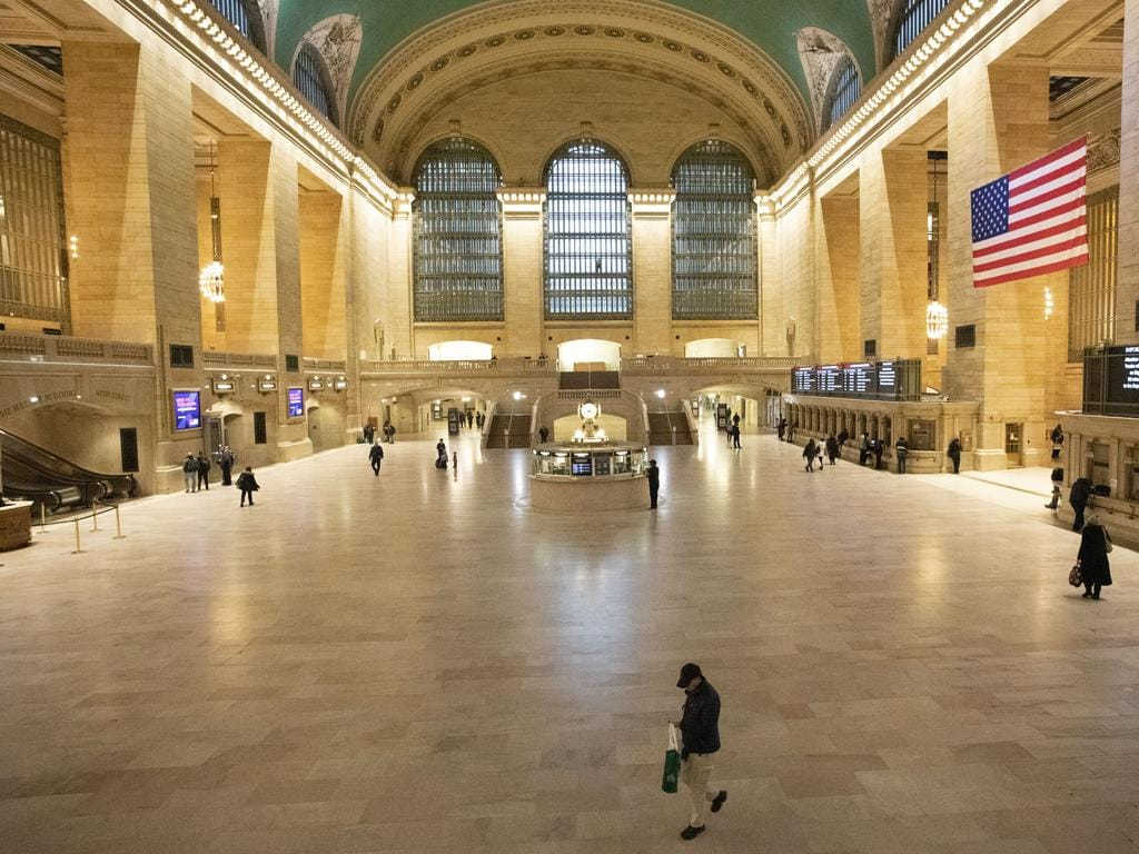 Commuters pass an empty Grand Central Terminal in New York. Image: AP