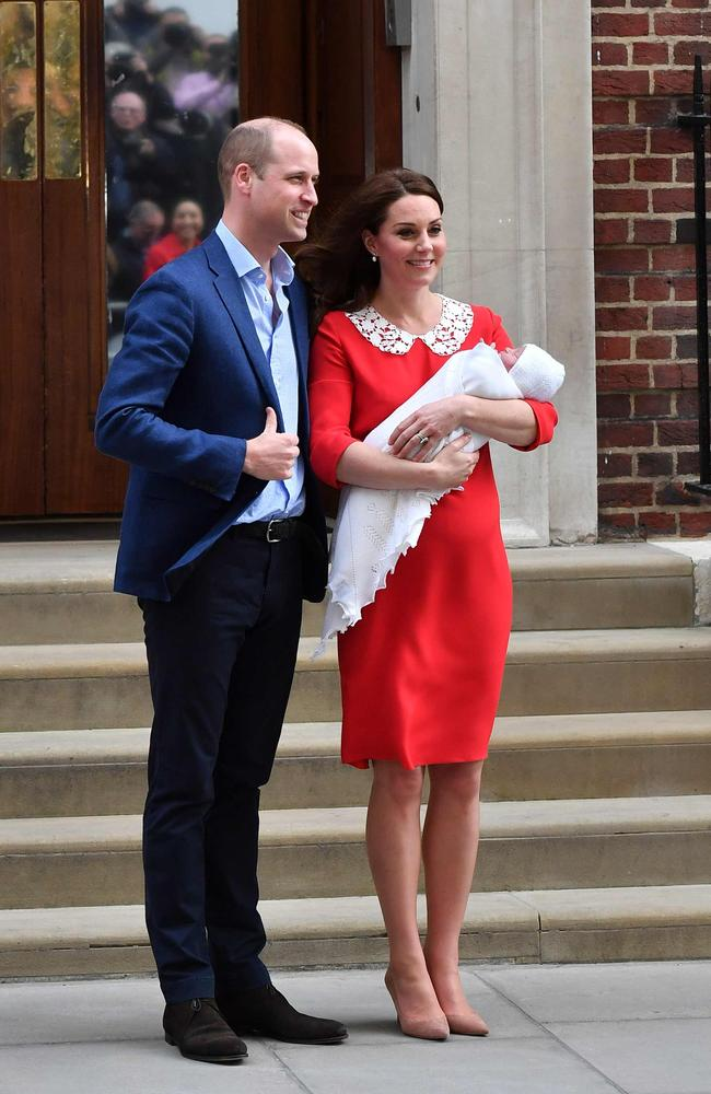 The Duchess of Cambridge looked radiant in red as the royals showed off their newborn son. Picture: AFP Photo / Ben Stansall