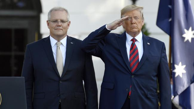 Australian Prime Minister Scott Morrison and US President Donald Trump listen to their National Anthems during a State Arrival Ceremony on the South Lawn of the White House in Washington, Friday, September 20, 2019. Picture: AP /Susan Walsh.