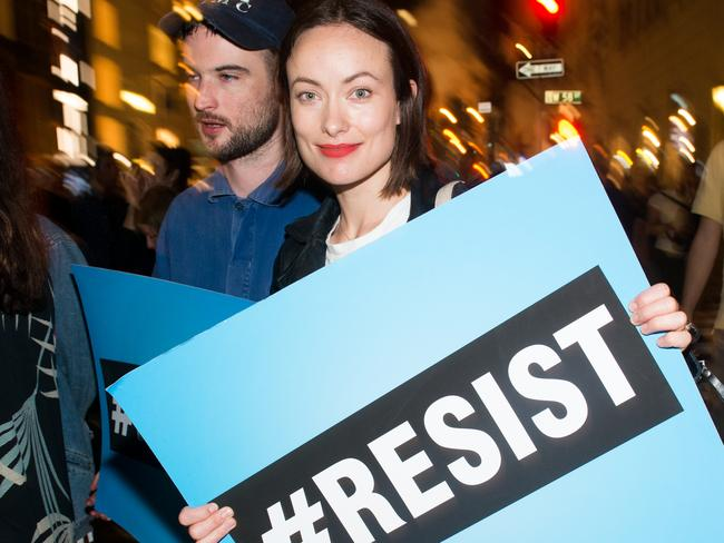 Olivia Wilde joins Michael Moore as he protests against President Donald Trump. Picture: Getty