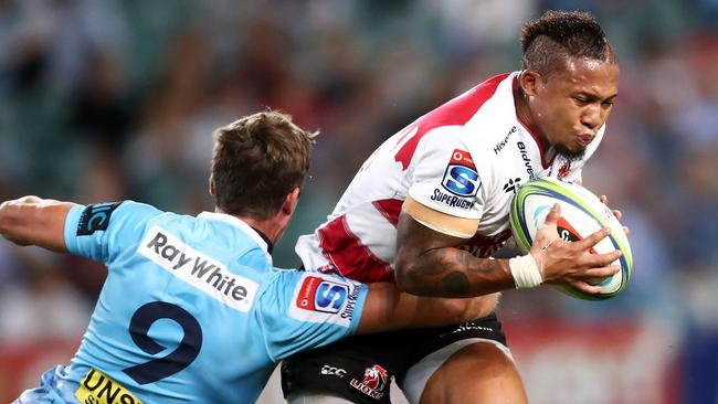 Elton Jantjies of the Lions is tackled by Jake Gordon of the Waratahs in April.