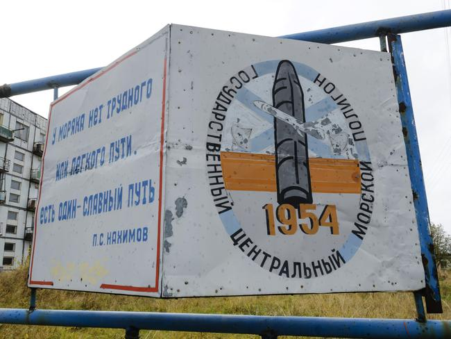 A sign in the village of Nyonoksa reads: 'The State Central Navy Testing Range'. Picture: Sergei Yakovlev/AP