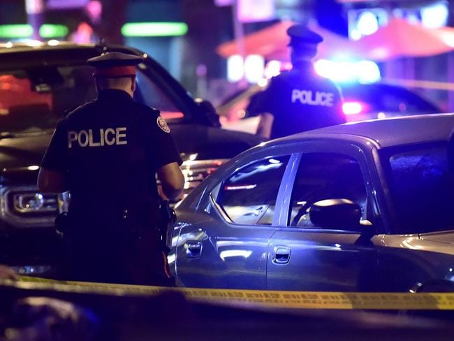 Police work the scene of a shooting in Toronto. Picture: AP
