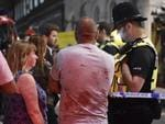 People speak with police officers after an incident near London Bridge in London, Britain June 4, 2017. REUTERS/Hannah Mckay - RTX38VY5