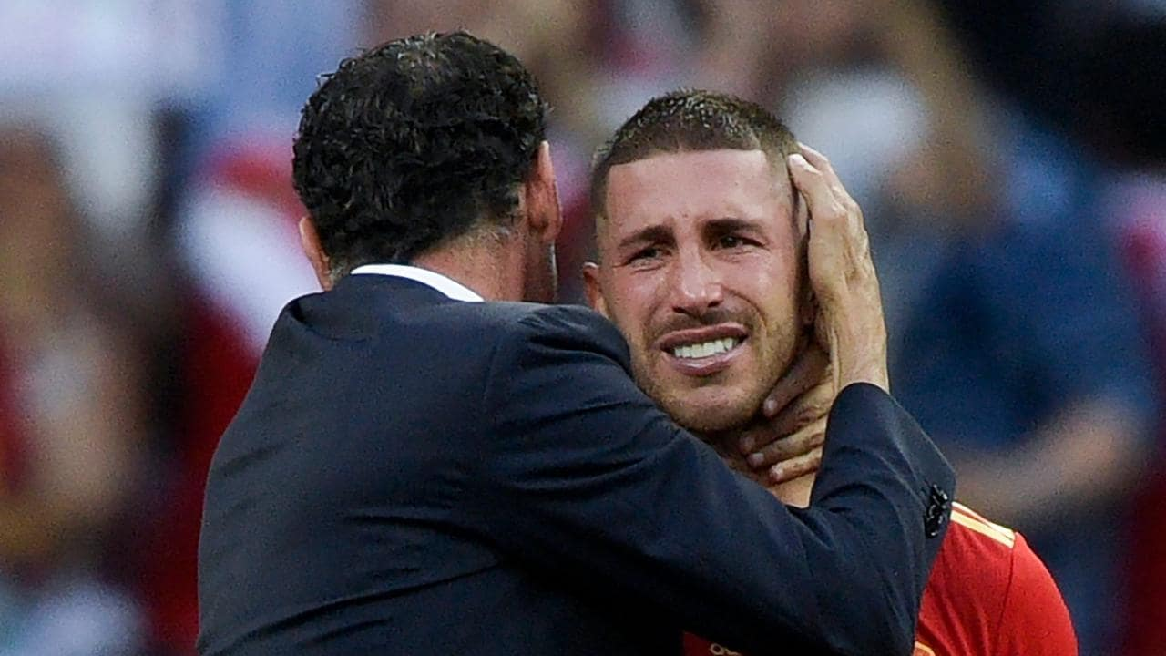 Ramos cries in the arms of Fernando Hierro.