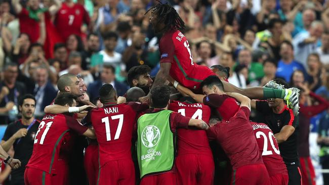 Portugal's players celebrate the opening goal during the Euro 2016 final.