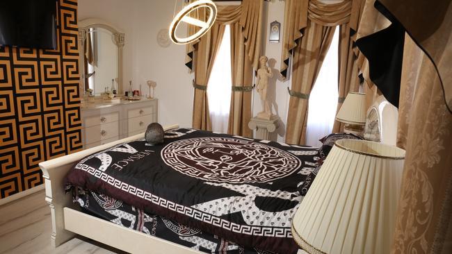 The Tsikouris' Versace bedroom. Picture: Robert Pozo