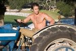 <p>HIT The Back Up Plan .. Stan (ALEX O'LOUGHLIN) on his tractor at the farm.</p>