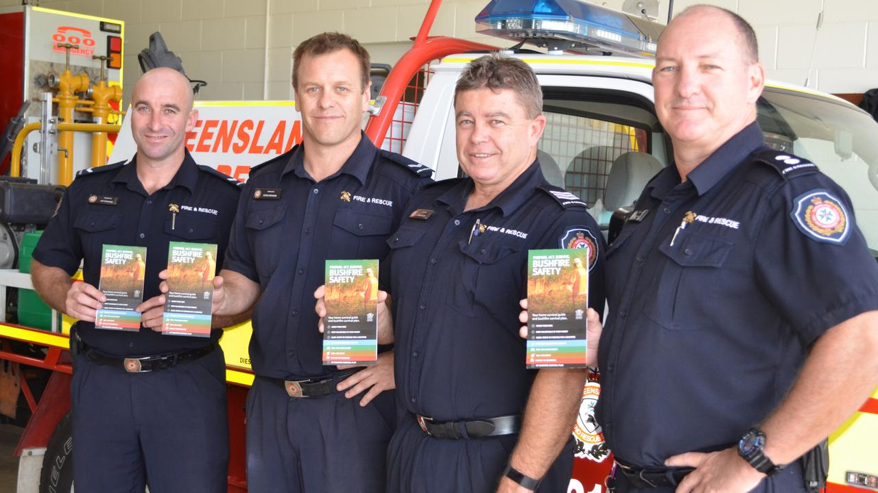 Queensland Fire and Emergency Services staff Jay Stanton, Peter Orchard, Steve Olver and Brett Holmes were out early in the season handing out bushfire safety pamphlets.