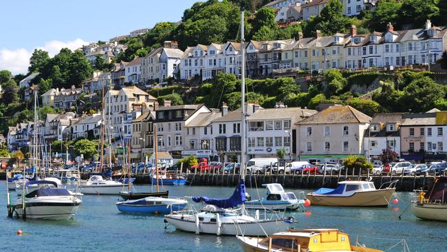 Boats in the estuary at Looe, Cornwall, UK, near where the Snooty Fox sits. Picture: Alamy
