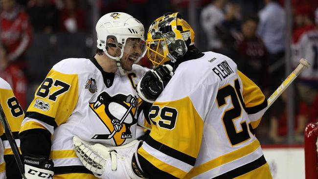 Sidney Crosby #87 and goalie Marc-Andre Fleury #29 of the Pittsburgh Penguins celebrate.