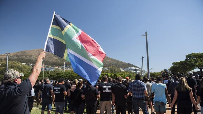 A protester waves a flag during a demonstration by South African farmers and farm workers at the Green Point stadium to protest against farmer murders in the country.